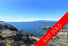 2.5 Acres of Southwest Facing Waterfront in Halfmoon Bay For Sale