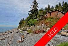 RARE Private Low-Bank Waterfront Home For Sale in Roberts Creek