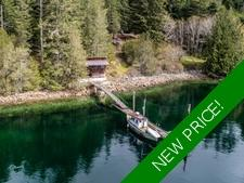 Waterfront Acreage with Cottage & Dock in Garden Bay For Sale